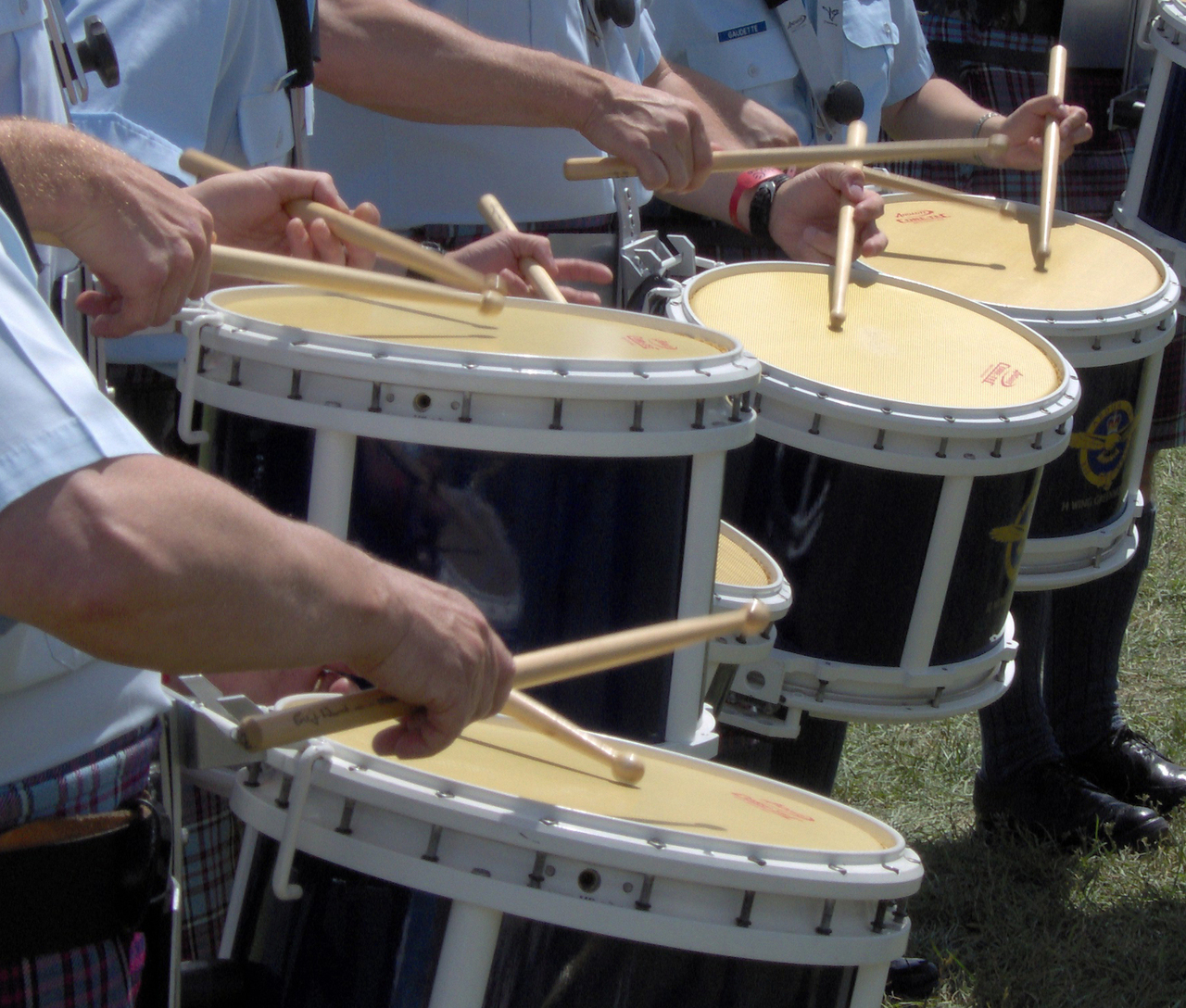 Side Drummers playing marching drums traditional grip