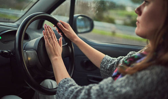 Women pressing car horn